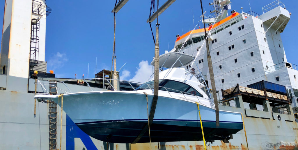 45 foot hatteras being lifted onto yacht transport ship